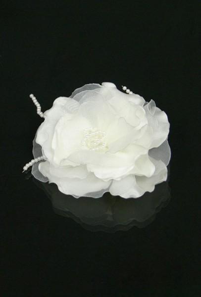 Blume mit Perle auf Haarclip